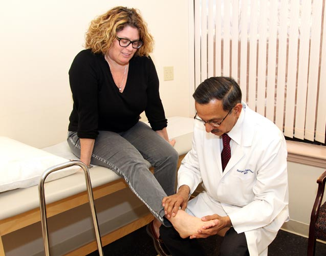 Dr. Sachdev with a patient.