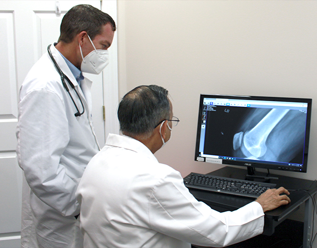 Dr. Sachdev reviewing x-ray
